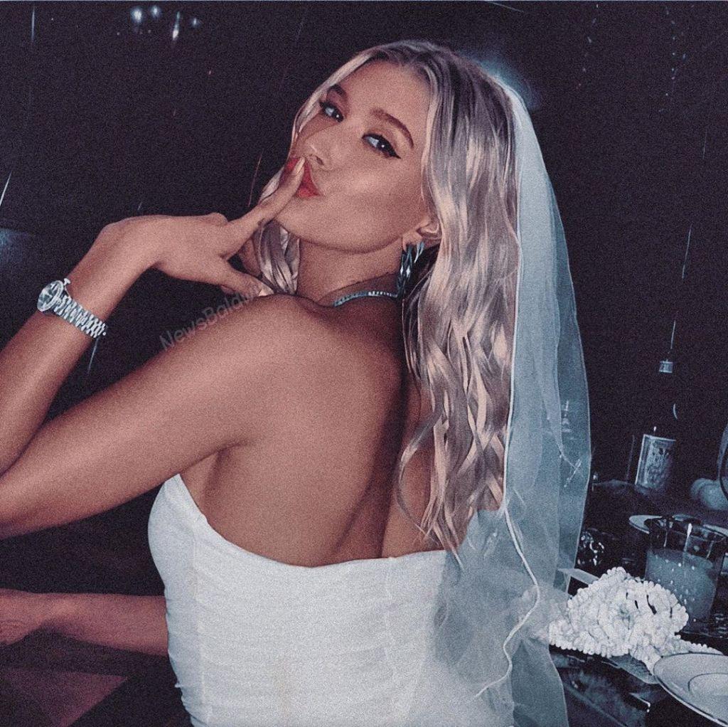 Hailey Baldwin posses in her wedding dress