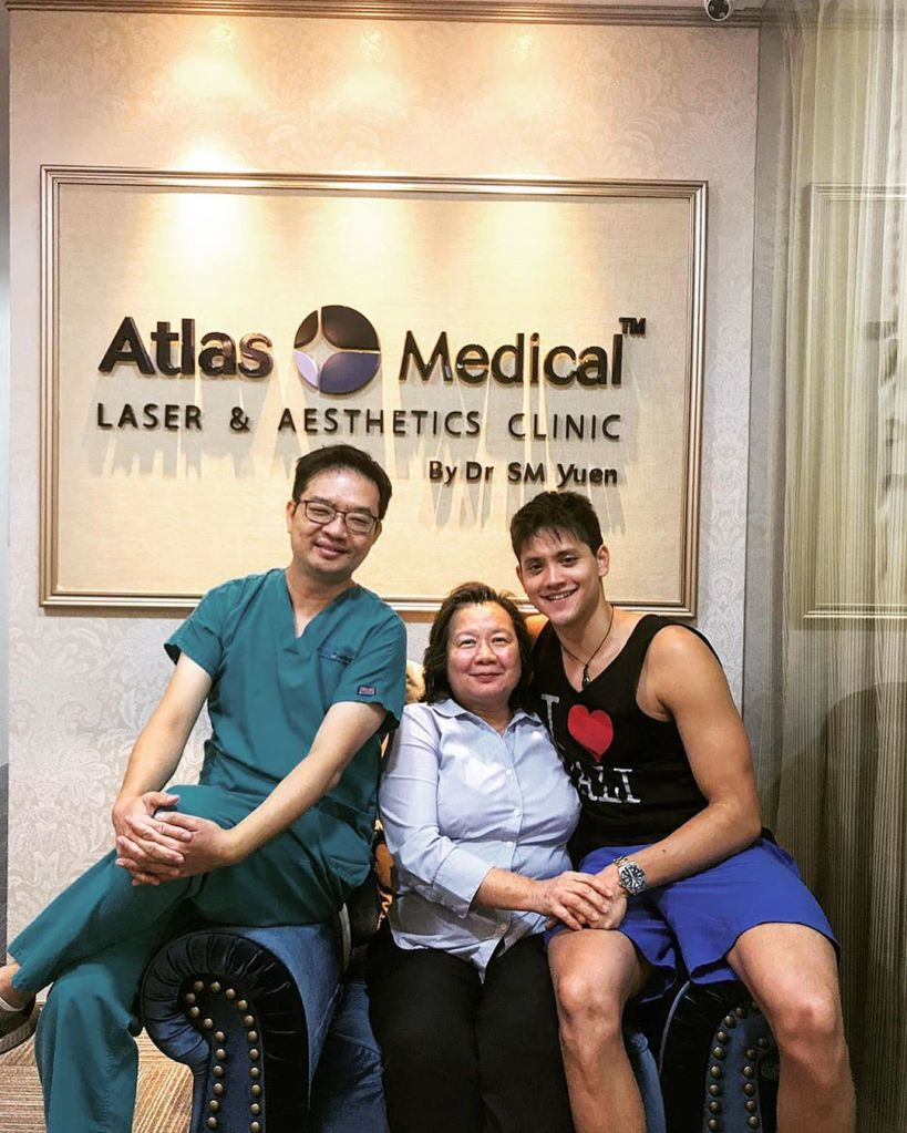 Joseph Schooling posing in a photo with Dr SM Yuen in front of Atlas Medical Laser and Aesthetics Clinic