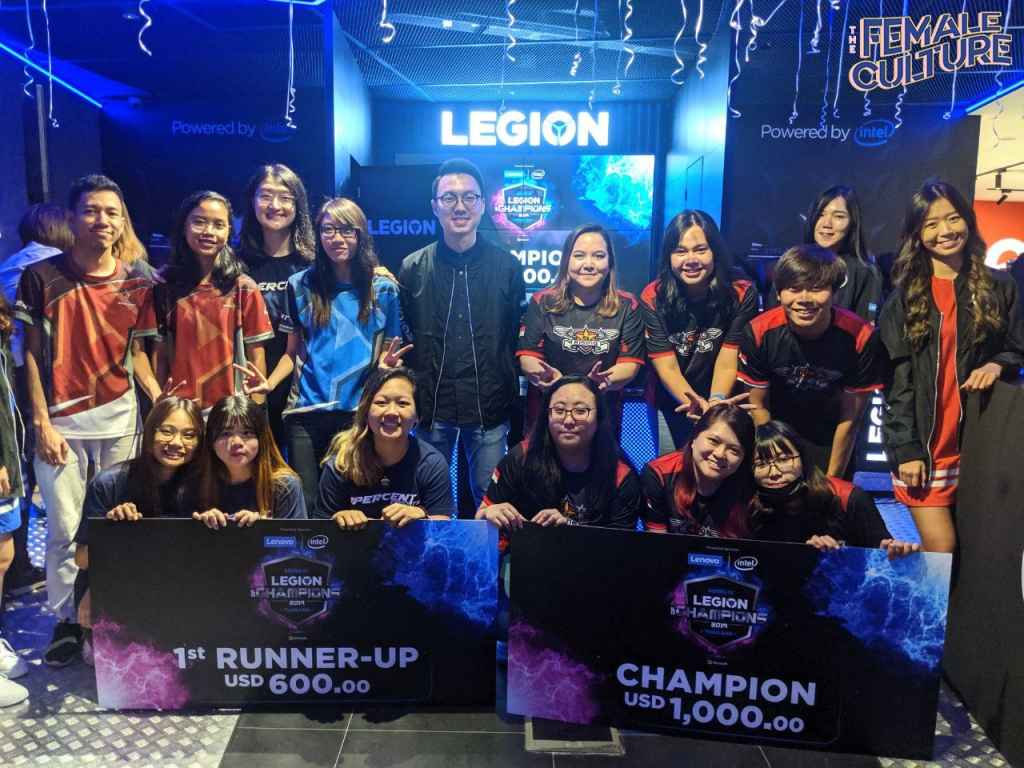 The champion and first runner-up from Lenovo and Intel's Legion of Valkyries (Singapore category) posing with their cash prize