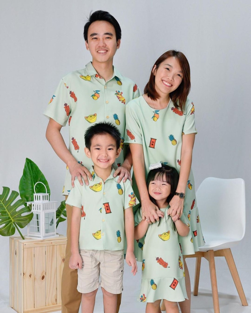 Family dressed in matching printed with gold, Chinese firecrackers, pineapple and orange from All Would Envy